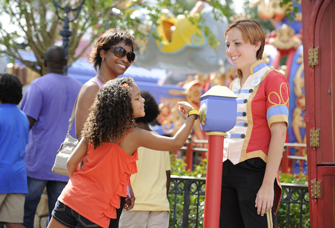 Walt Disney World Resort guests use MagicBands for FastPass+ access to experiences and attractions such as Dumbo the Flying Elephant at Magic Kingdom in Lake Buena Vista, Fla. Guests also can use MagicBands to enter their Disney Resort hotel room, buy food and merchandise, enter Walt Disney World Resort theme parks and water parks, and connect to Disney's PhotoPass. MagicBands are part of the new MyMagic+, which has the ability to connect nearly all aspects of the guest vacation experience at Walt Disney World Resort. (Mark Ashman, photographer)